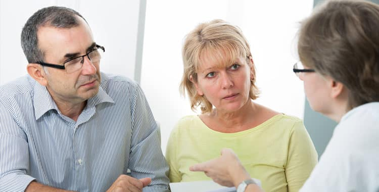 Retired couple talking to an adviser